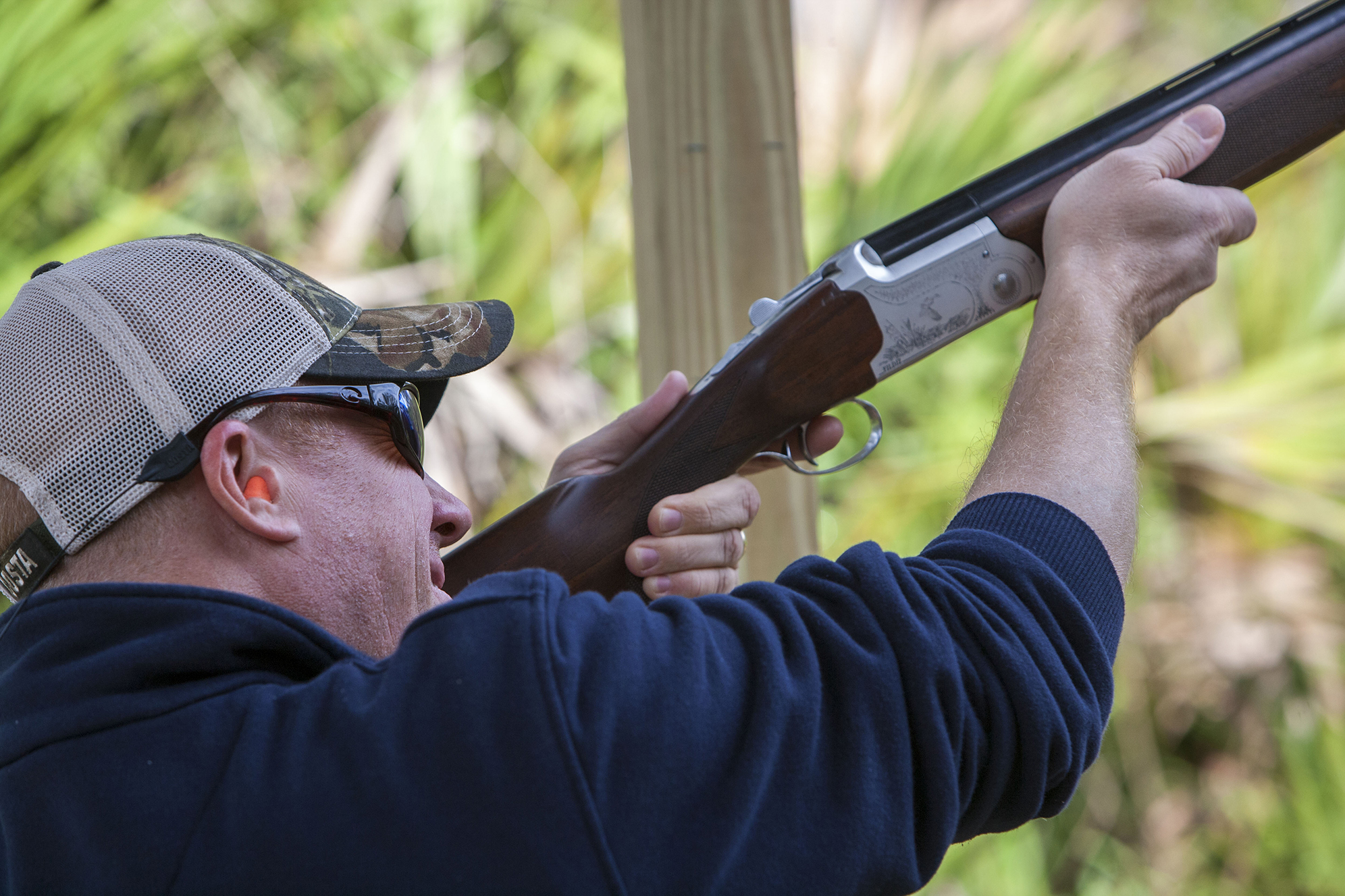 """PCRP Executive Chairman Nick DiCeglie fires his 12-gauge shotgun at a sporting clay. DiCeglie began the sport about 10 years ago and said the event was a good way to """"change things up a bit, have some fun and celebrate our Second Amendment rights."""""""