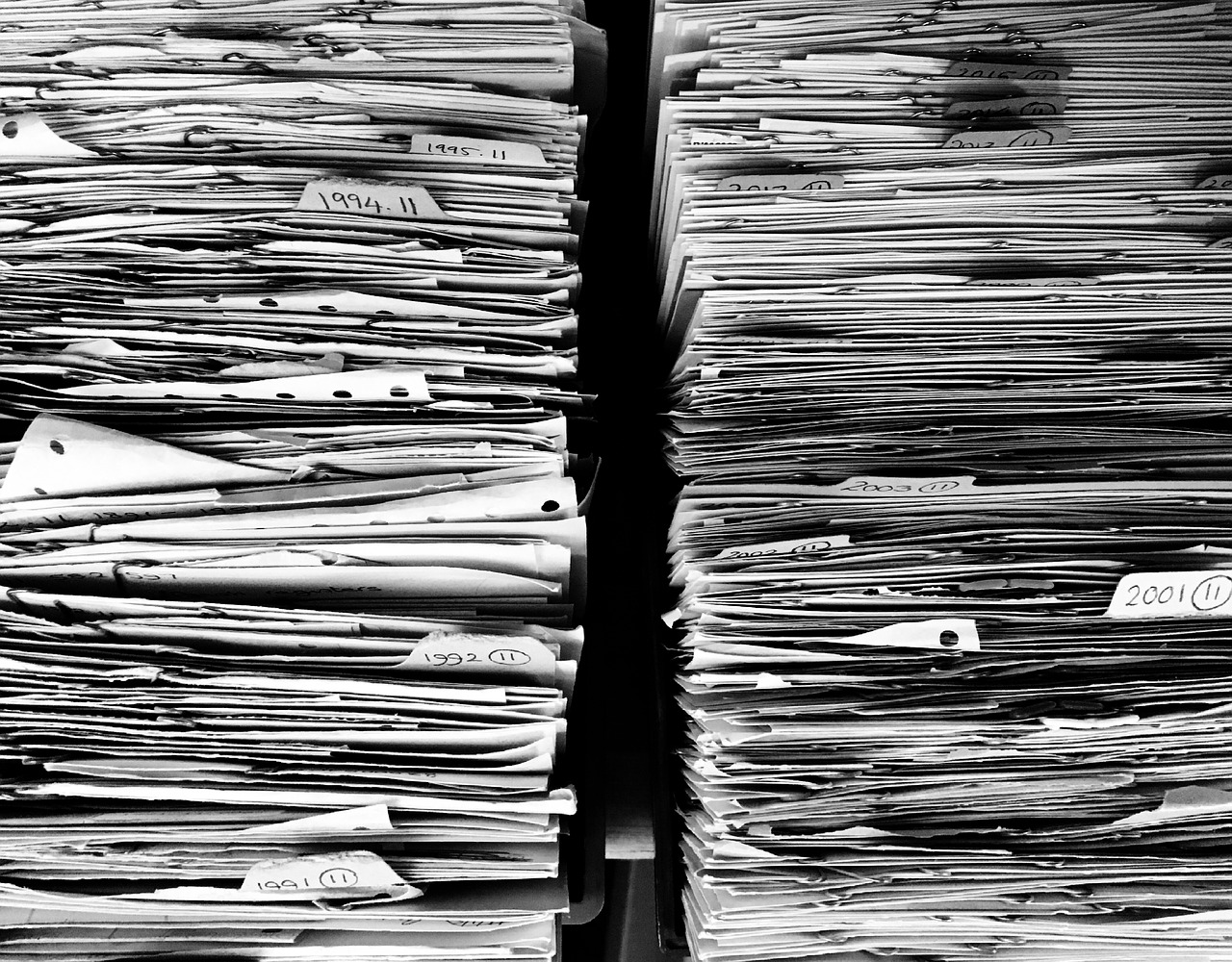 stacks of files and paperwork